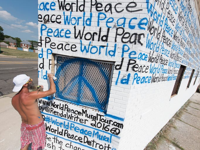 Florida artist Renda Writer creates a mural as part