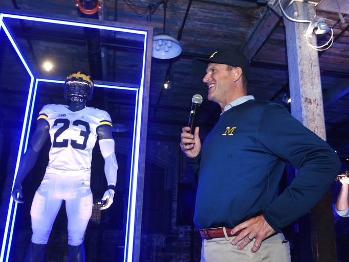 University Michigan football coach Jim Harbaugh speaks