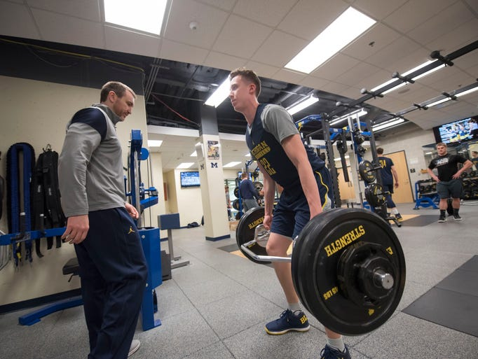 Michigan guard Duncan Robinson lifts weights under
