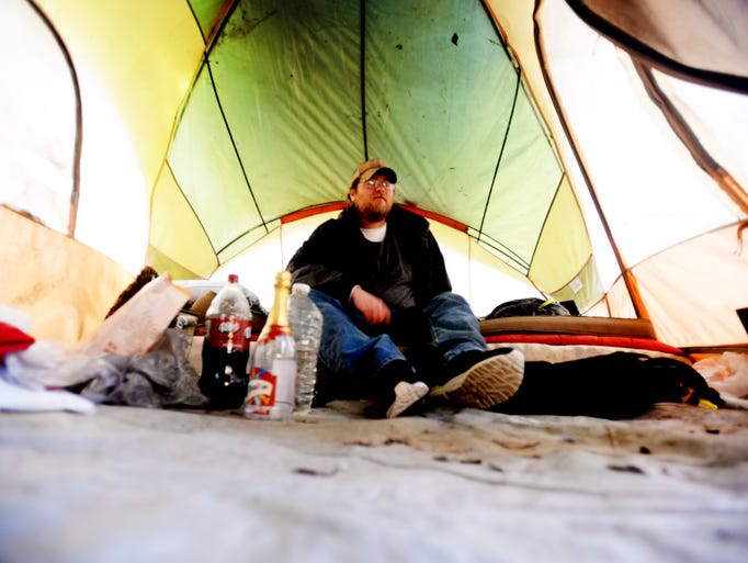 Nick Kennedy in his tent in the woods in downtown Shreveport.