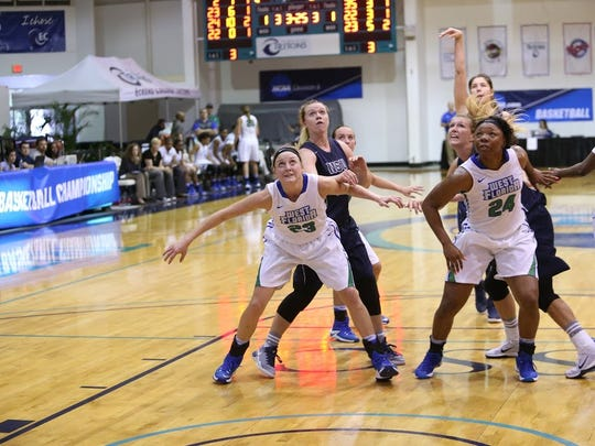UWF's Kate Bobos (23) and Toni Brewer, both in position for a rebound in Friday's NCAA Tournament win against Nova Southeastern, combined for 42 points and 23 rebounds as the Argos advanced into Saturday's South Region Semifinal in St. Petersburg.
