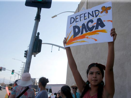 San Juan Bautista resident Cristal Gonzalez defends DACA during a demonstration in Salinas on Tuesday.