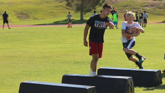 Virgin Valley High School football players and coaches conducted a two-day camp for the Sun Youth Football League this week.