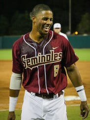 Florida State freshman outfielder J.C. Flowers reacts