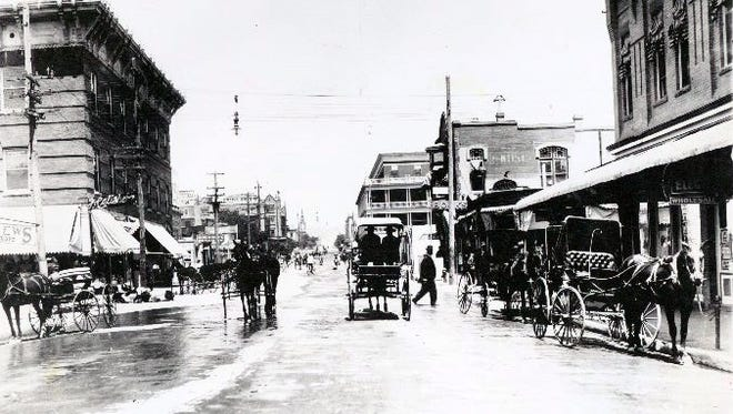 Looking north on Mesa from San Antonio. Four-story building at left is Calisher Building. (Mayor Robinson killed in fire which destroyed this building.) Note Crawford Theater far up on left; Orndorff Hotel at Mill St. on right. Date possibly 1898. Austin & Marr Insurance Co. on right.