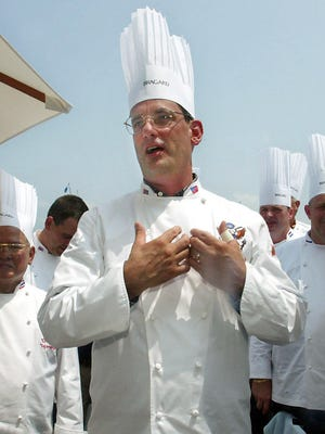 White House chef Walter Scheib greets chefs from around the world at the Chesapeake Bay Maritime Museum in St. Michaels, Md., July 27, 2004.