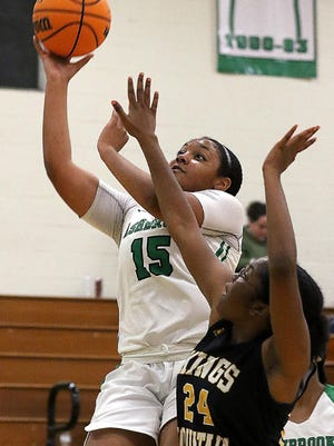Ashbrook's Zoey Ward drives to the basket past Kings Mountain's CoRey Simpson during their game Tuesday evening at Ashbrook High School.