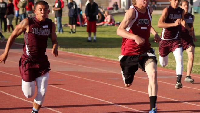 Tularosa senior Ivan Duran, far left, sprints past Corona's Sam Brown during the 100-meter dash of the Rose Relays on Friday afternoon at Bob Cerny Stadium.