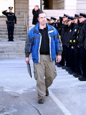 """Elmira Police Department Capt. Dennis Collins is honored with a """"walkout"""" ceremony to mark his retirement after 24 years of service."""
