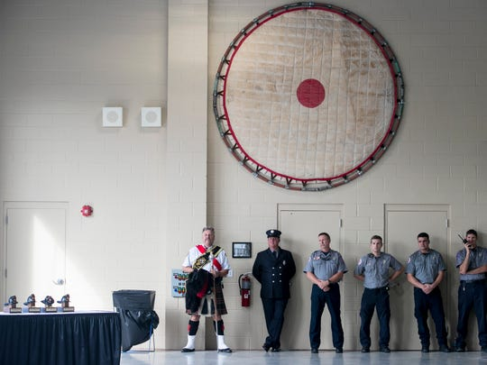 Firefighters from Station 1 listen to speakers at the ribbon cutting ceremony for their new building on Monday, December 5, 2016, in downtown Fort Myers.