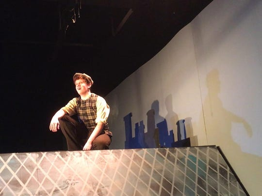 """Robert McCandlish (Bert) in the Holiday Cast looks out over the rooftops of London in """"Mary Poppins."""""""