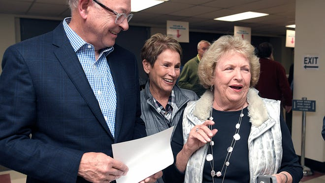 City of Franklin Mayor Ken Moore and his wife, Linda, share early voting numbers with Alderman Margaret Martin at the Williamson County Administration Complex in Franklin on Oct. 24, 2017.