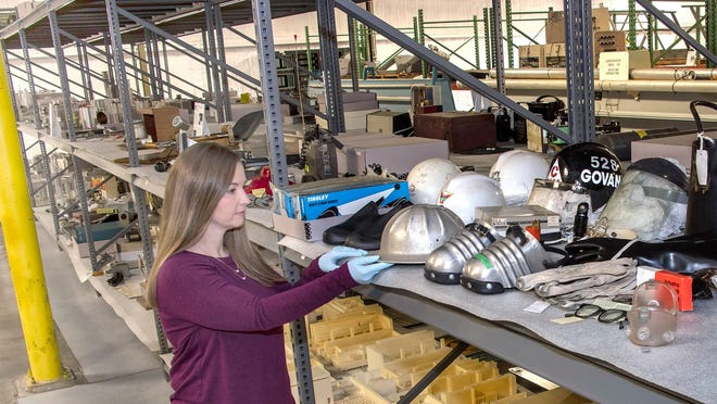 Melissa Hanson, curator for the Savannah River Site Curation Facility, adds another artifact to the vast collection of items carefully stored to preserve Cold War history at SRS.