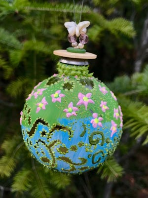 Handpainted glass ball ornament by Mary White, part of the ornament show Dec. 2 at Plum Bottom Pottery & Gallery. White will give a demonstration of her techniques for creating ornaments like this during the show.