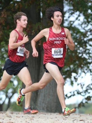 Michael Dua (8645) and Kieran Ungemach, both of Don Bosco Prep, are shown near the 1.5 mile mark of the race.  Ungemach came in third place, followed by Dua in fourth at Darlington County Park in Mahwah, Friday, October 13, 2017.