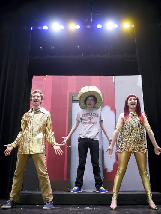The Brain, played by Cullen Maes dances along side Josh Peffley, as Zubrick, and Tilley Funk, as Yoni, during dress rehearsal. Cedar Crest High School will present The Brain From Planet X on March 5, 6, and 7. Advance tickets can be purchased in the lobby of the school from 9:00 a.m. to 2:00 p.m. Monday through Friday or in the lobby the night of the play. Michael K. Dakota - Lebanon Daily News