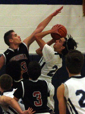 Churchill's Joan Andoni defends Stevenson's Gino D'Agostino during the second quarter of Tuesday's game.