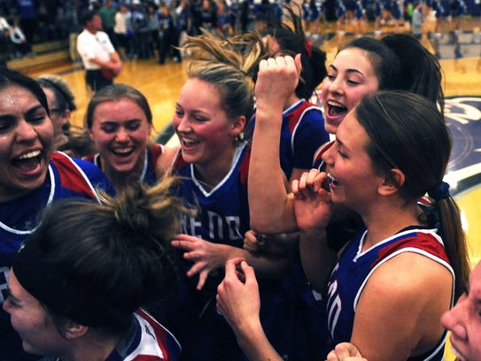 Reno players celebrate after defeating McQueen to win