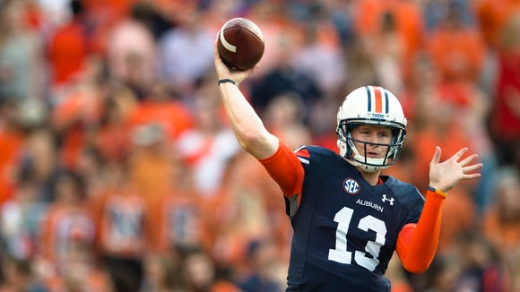 Auburn quarterback Sean White (13) throws a pass before the NCAA football game between Auburn and Mississippi State on Saturday, Sept. 26, 2015, in Auburn, Ala. 