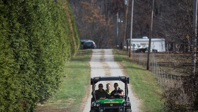 Police conduct a massive search of several homes in the 1800 block of N. Wheeling Avenue Thursday, Nov. 5, 2015. Chief of police Steve Stewart was unable to release any information regarding the search but cadaver search dogs and drug task force officers were at the scene.  An excavator and ground penetrating radar system were used in the backyard of one of the properties being searched.