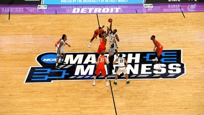 Michigan State tips off with Syracuse in the second round of the NCAA tournament at Little Caesars Arena on Sunday, March 18, 2018.