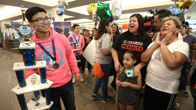 Saul Ramirez of the Henderson Middle School Chess Team arrives at the El Paso Internaitonal Airport along with his team to the cheers of family and friends Monday after winning the national chess championship. This is the third national championship by the Hornets in four years. Ramirez also won an individual national championship at the tournament.
