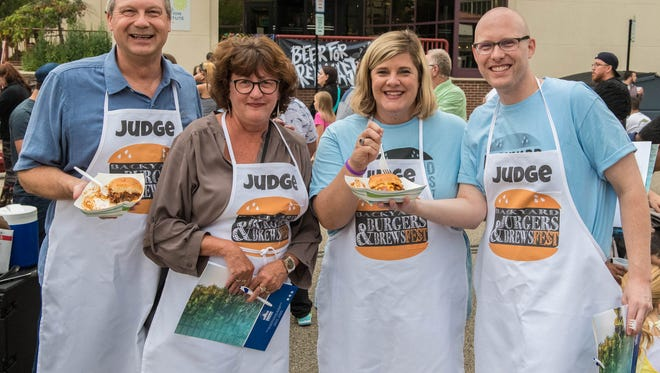 Kara Beer, Executive Director of Battle Creek Area Chamber of Commerce (second from right) lines up with fellow judges during the 2018 Backyard Burgers and Brewsfest in downtown Battle Creek. The event returns downtown Saturday following a one-year hiatus.