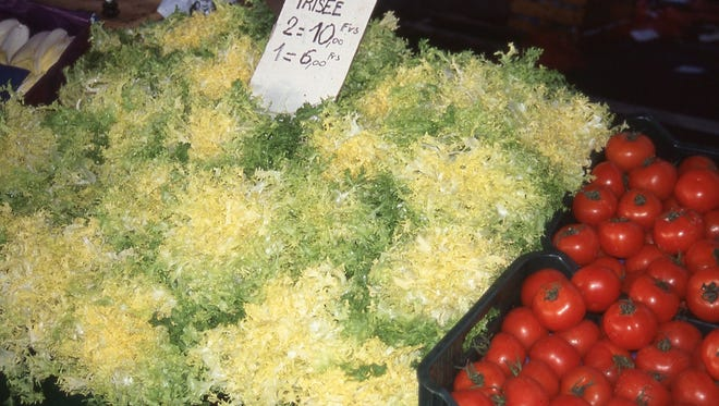 Blanched heads of frisee endive for sale at a market in Salon, France. MUST CREDIT: Barbara Damrosch.