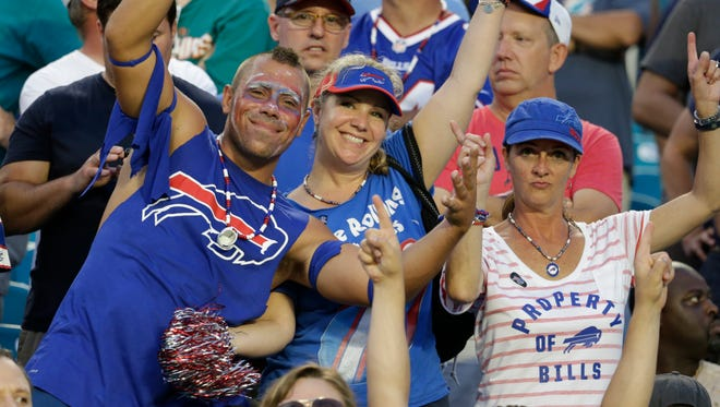 Buffalo Bills fans cheer during a game against the Miami Dolphins on Sunday, Sept. 27, 2015, in Miami Gardens, Fla.