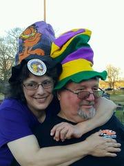 Billy Robinson enjoys Mardi Gras with Cathy.
