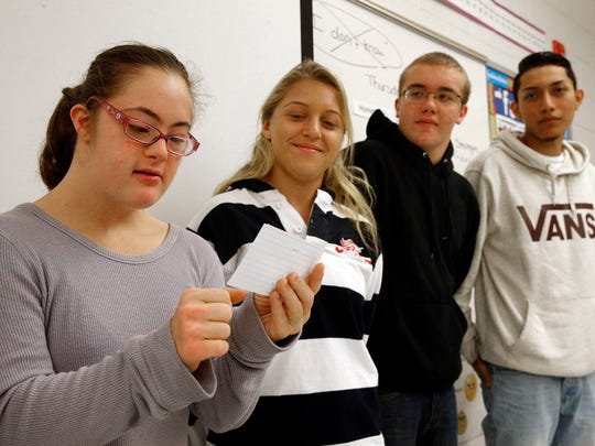 "Jackson Liberty High School student Jessica Reiter, 19, reads an exercise during the ""Thursdays with Friends"" session, November 3, 2016.   Also shown are (l-r): Carly O'Connor,  Jacob Alber, and Jorge Veloz, all 17.  The weekly class helps build build empathy and fosters social-emotional growth in students there."