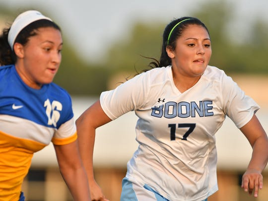 Boone County's Iris Gomez battles for a ball at  Soccerama at Dixie Heights High School Friday, August 11th