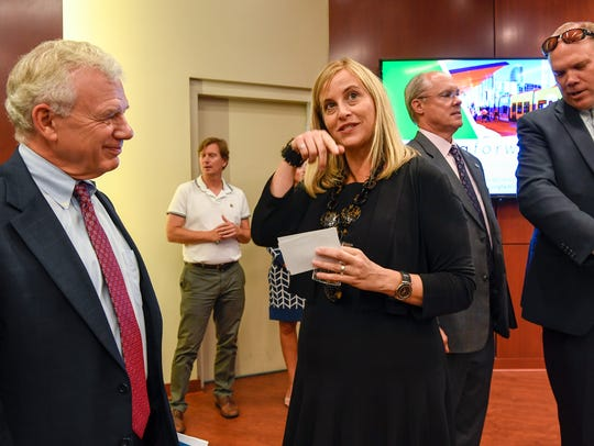 Mayor Megan Barry talks with Dr. Bill Fox of Knoxville at Lipscomb University in Nashville on Aug. 16, 2017. Sgt. Robert Forrest Jr. is pictured behind Barry.