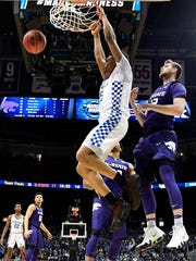 Kentucky forward Kevin Knox (5) dunks the ball against Kansas State forward Dean Wade (32) during the first half of a regional semifinal NCAA college basketball tournament game, Thursday, March 22, 2018, in Atlanta. (AP Photo/John Amis)