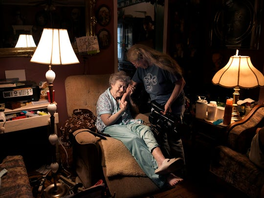 Lucille Phipps, 89, embraces the arm of Lynne Stoddart