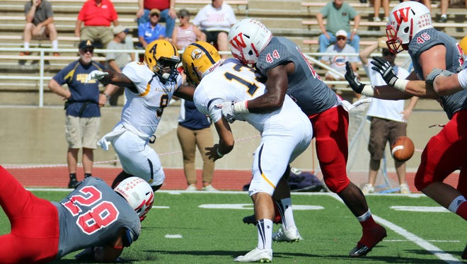 Senior linebacker AJ Akinribade (44), shown here forcing a fumble, is confident that the Little Giants have the right motivation to secure the program's sixth straight Monon Bell Classic win on Saturday.