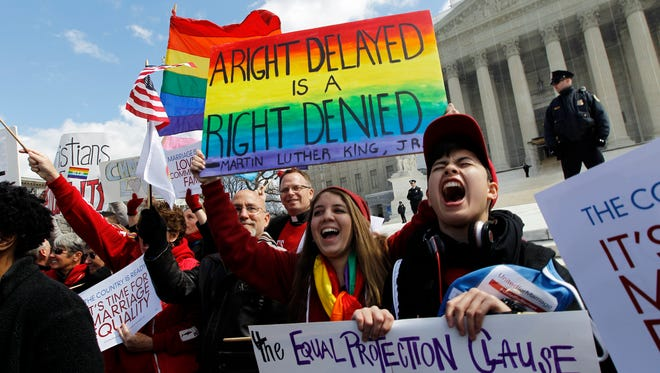 Gay rights demonstrators gather in front of the Supreme Court during oral arguments in March.