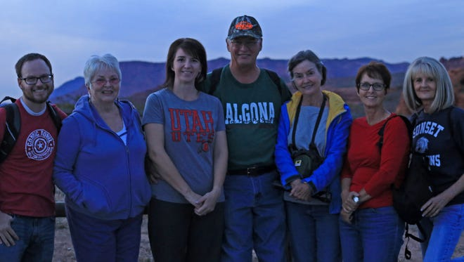A group of hikers gathers with reporter Brian Passey, left, and Sue Kimball, second from left and founder of the Erin Kimball Memorial Foundation, Saturday before a BackTrek charity hike in the Red Cliffs Desert Reserve.