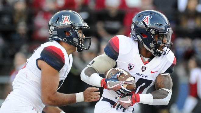 Nov 5, 2016: Arizona Wildcats wide receiver Samajie Grant (10) takes the hand off from Arizona Wildcats quarterback Anu Solomon (12) during a game against the Washington State Cougars during the second half at Martin Stadium. The Cougars won 69-7.