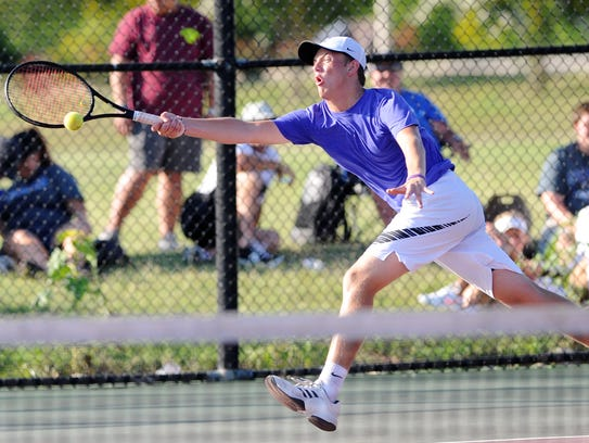 Wylie's Davyn Williford reaches for a shot during the