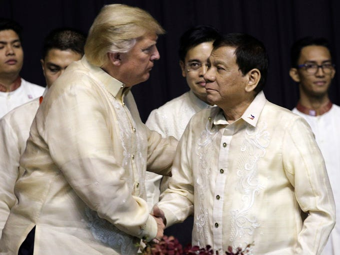 President Trump shakes hand with Philippines President