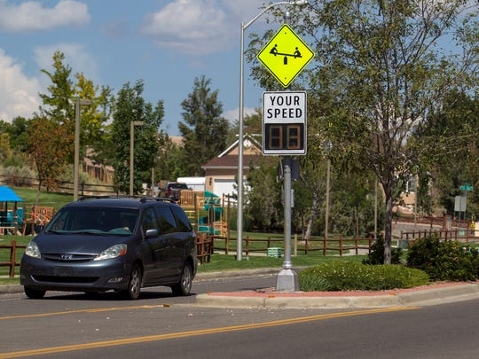 Vehicles drive past Colinas Del Norte Park on Tuesday, Sept. 12, 2015 on North Dustin Avenue in Farmington.