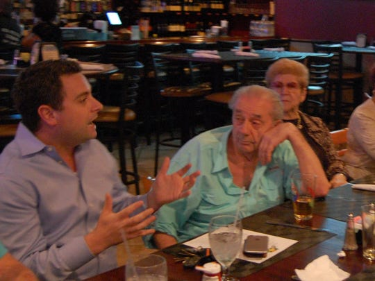 Cape Coral Italian American Club attorney Richard M. Ricciardi (left) met with disgruntled club members last month at a Cape Coral restaurant.