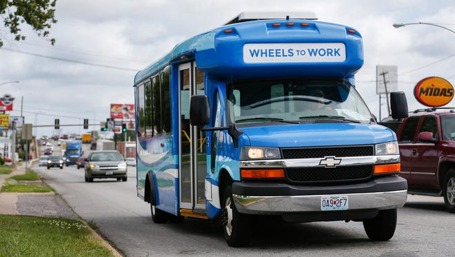 The Wheels to Work bus heads down Glenstone Avenue on Tuesday, June 13, 2017.