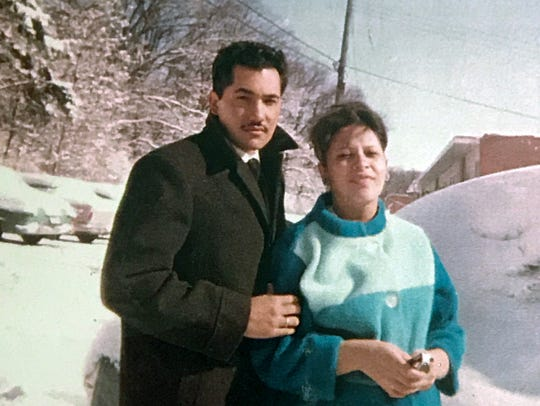 Luciano and Martha Barraza pose in front of their snow-covered