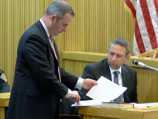 Monmouth County Assistant Prosecutor Chris Decker (left)
