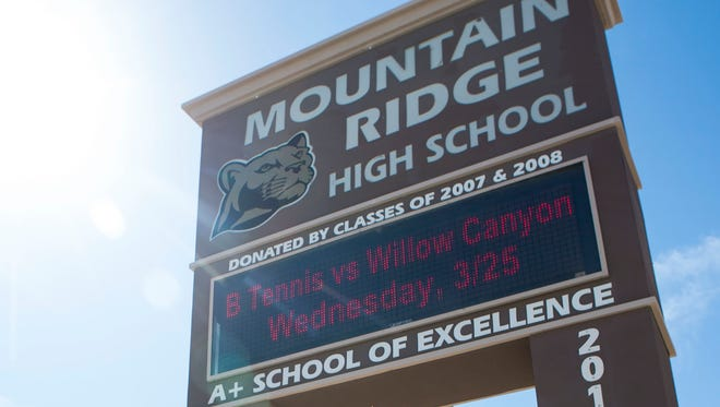 Two former students from Mountain Ridge High School  in Glendale are accused of sexually assaulting a fellow member of the wrestling team.