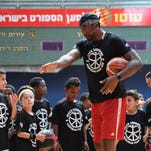 Amar'e Stoudemire takes a selfie with fans during a visit to Israel Museum on August 9, 2016.