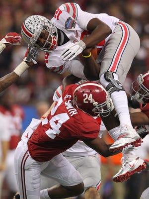Alabama safety Geno Smith (24) tackles Ohio State quarterback Cardale Jones in the 2015 Sugar Bowl.