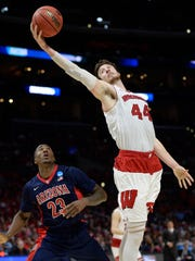 Wisconsin Badgers forward Frank Kaminsky grabs a rebound against Arizona Wildcats forward Rondae Hollis-Jefferson in the finals of the west regional of the 2015 NCAA Tournament.